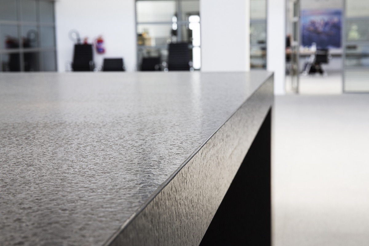 Artmar-GRANITE_COMMERCIAL-PROJECT_Kitchen-Aid-Head-Office-Showroom_Speckled-White-Granite-Flooring-Antique-Zimbabwean-Black-Countertops-with-specialised-mitered-edging-and-waterfall_Supply-Fit-2.jpg