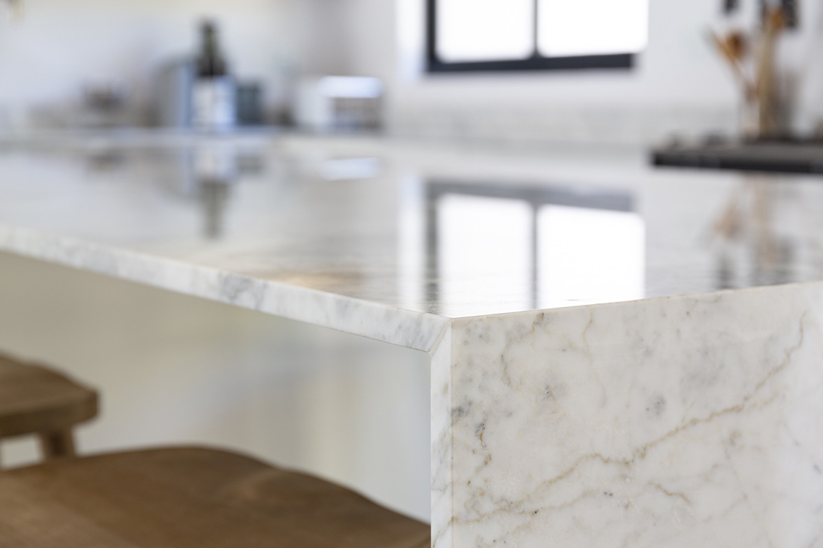 Artmar-MARBLE-SLABS_20mm_Carrara-Marble-Slabs_Polished-Finish_Waterfall-mitered-edge_Kitchen-supplyFit-.jpg