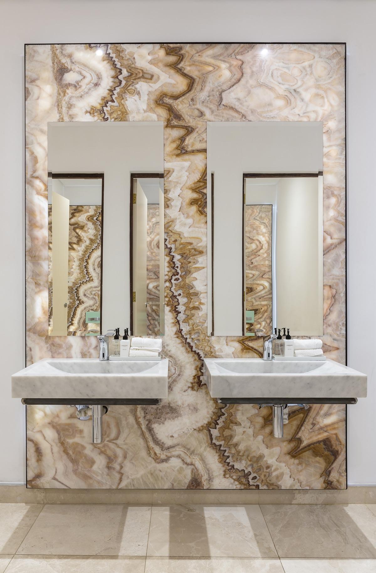 Artmar-MARBLE-SLABS_COMMERCIAL-PROJECT_Lanzerac-Hotel_Honey-Rainbow-Onyx-Feature-wall_-Supply-Fit-with-Crema-Marfil-Marble-floors-Custom-Mugla-Marble-Basins-1.jpg