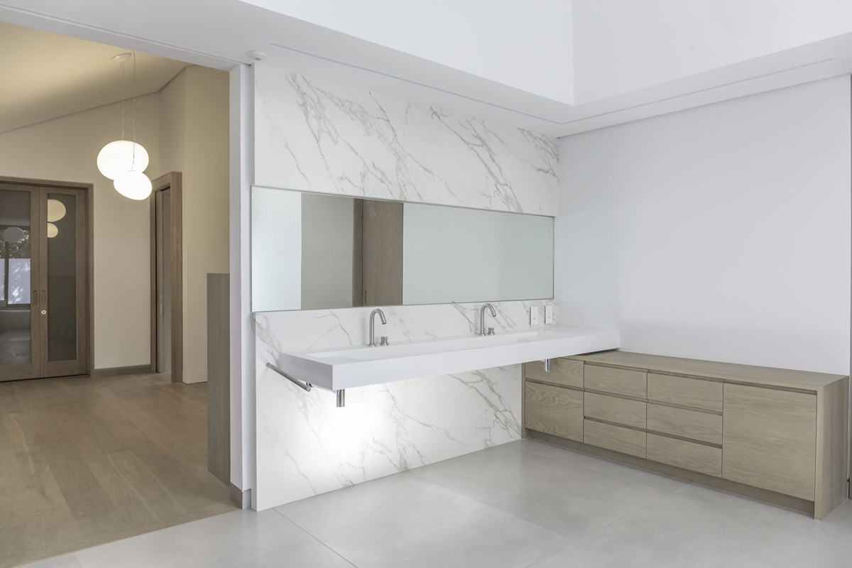 Artmar-NEOLITH-SINTERED-STONE_RESIDENTIAL-PROJECT_Calacatta-Silk-Neolith-12mm-slabs_Custom-integrated-basin-Feature-Wall_Supply-Fit.jpg